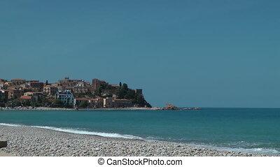 The shore near Castel di Tusa - Sea waves slowly hit on the...