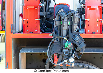 The side view of equipment packed neatly inside a fire engine