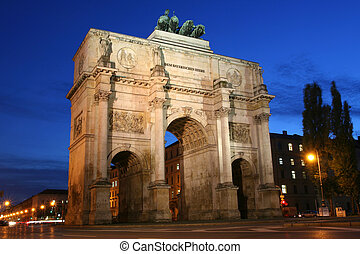 The Siegestor (Victory Gate) in Munich is an arch crowned with a statue of Bavaria with a lion-quadriga