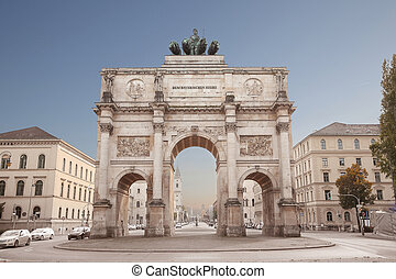 The Siegestor in Munich, Germany. Victory Gate, triumphal arch crowned with a statue of Bavaria with a lion-quadriga. Located between the Ludwig Maximilian University and the Ohmstrasse.