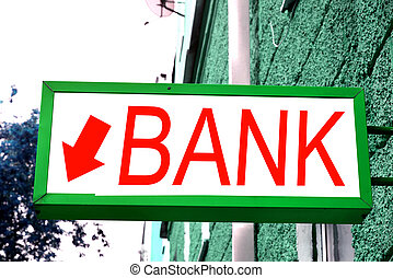 "The sign ""Bank"" on the wall"