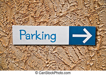 The Sign of parking on wall