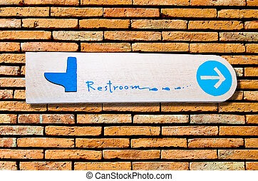 The Sign of restroom on wall background