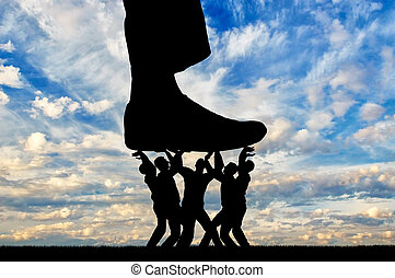 The silhouette of a large leg presses on a crowd of people that resists it