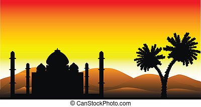 The silhouette of a mosque in the desert