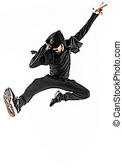 The silhouette of one hip hop male break dancer dancing on...