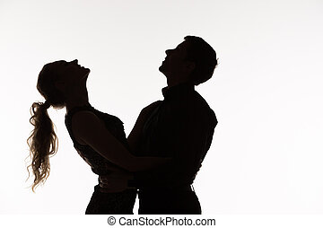 The silhouette of romantic couple
