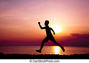 The Silhouette of runner on the beach