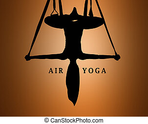 The silhouette of Young woman doing anti-gravity aerial yoga...