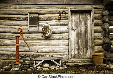Exterior wall of a historical log cabin in Midwest America. This is a historical public display in Maysville, Michigan. It is not a a private property or residence