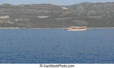 The sink city Kekova and yacht with tourists, Antalya,...