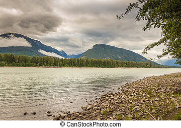 The Skeena River at Shames Mountain on a cloudy day in the summer, in British Columbia, Canada.