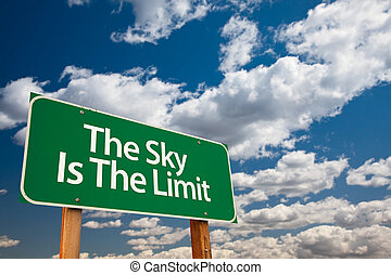 The Sky Is The Limit Green Road Sign with Dramatic Clouds...