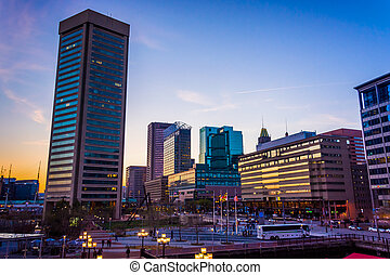 The skyline at sunset, at the Inner Harbor in Baltimore, Marylan