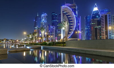 The skyline of Doha by night with starry sky seen from Park timelapse, Qatar