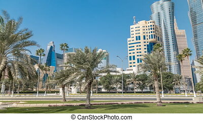 The skyline of Doha seen from Park timelapse, Qatar. Trees...