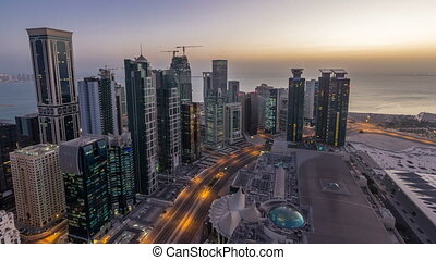 The skyline of the West Bay area from top in Doha night to day timelapse, Qatar.