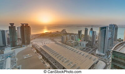 The skyline of West Bay and Doha City Center during sunrise...