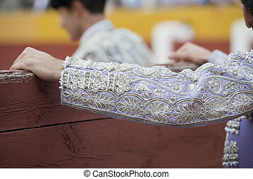 The sleeve of the jacket of a bullfighter.