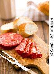 sliced chorizo salami on cutting board