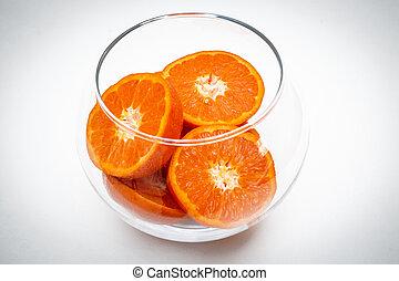 the slices of fruit orange in glass vase