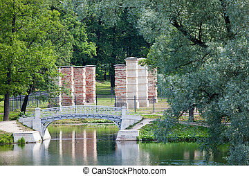 The small bridge in park over a pond