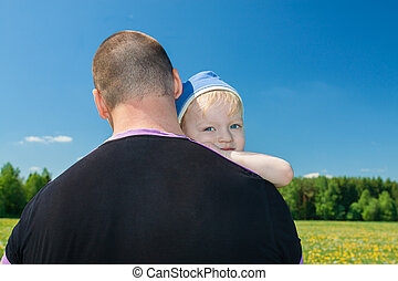 small child with the father on walk in park