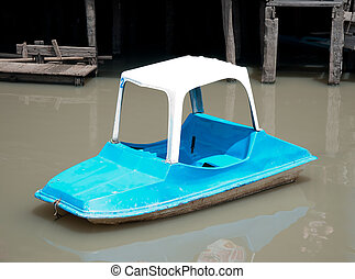 The Small pedal boat on river