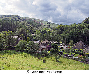 the small village of cragg vale in west yorkshire surrounded by pennine hills and trees