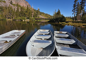 The small white boats on a quiet lake