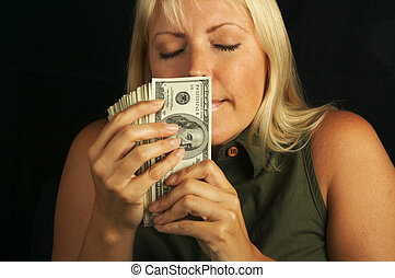 The Smell of Money - Attractive Woman Enjoys the Smell of ...
