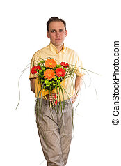 The smiling man with a bouquet