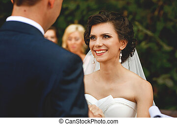 The smilling bride on the wedding ceremony