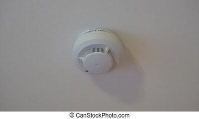 the smoke detector alarm on belom the ceiling in the...