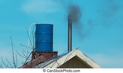 The smoke from the chimney.