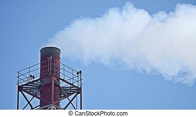 The smoke industry from the chimneys of the CHP. Pollution of the environment. Environmental disaster. Blue sky.