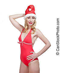 The Snow Maiden. The blonde in a cap of Santa Claus