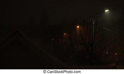 The Snowstorm at Night - Snowstorm night street lights snow...