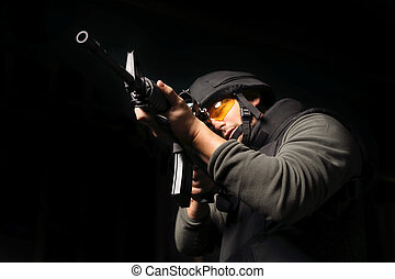 The soldier fires a rifle at the shooting range