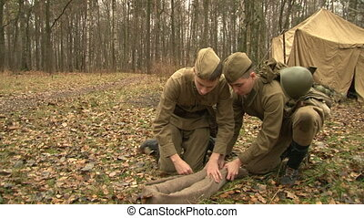 The soldiers at the camp rolled down coat