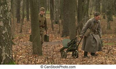 The soldiers dragged the machine gun