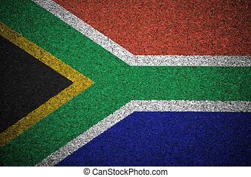 The South African Republic flag painted on a cork board.