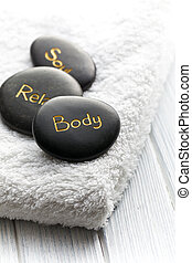 spa stones on white towel - the spa stones on white towel