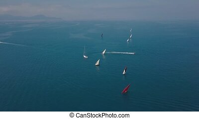The span of the drone over the sea near the coast of Italy. Boats and ship on the water. Mediterranean Sea. Aerial view.