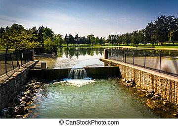 The spillway at Kiwanis Lake in York, Pennsylvania. - The...