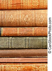 The Spines of a Stack of Antique Books Fill the Frame.