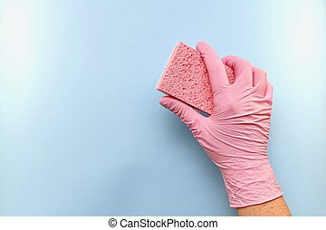 The sponge in a gloved hand keeps it tilted.
