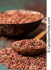The spoon with red rice
