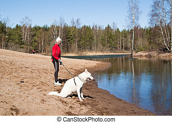 sports woman with a dog