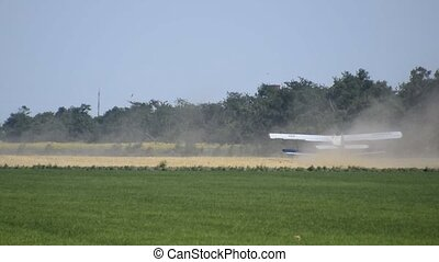 The spraying of fertilizers and pesticides on the field with...